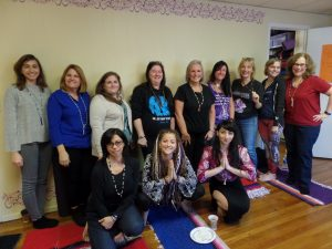 Jessica, Adria, and the participants with the mala beads they created