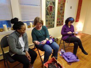 Kira helping new member Rebekah learn to crochet