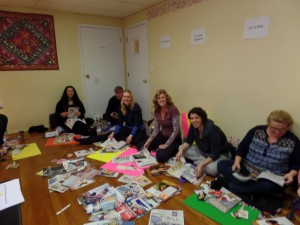 The participants selecting images for their vision boards