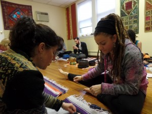 Jessica helping Andrea with her mala