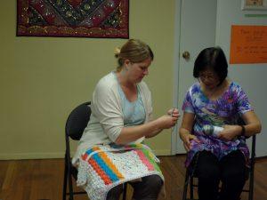 Kira teaching Hellen how to crochet