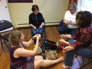 Kira showing newcomers how to crochet