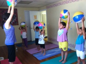 The children & Lucia in part 2 learning poses with their beach balls